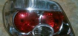 Фонарь левый комбинированный Mitsubishi Outlander (2001-2008)